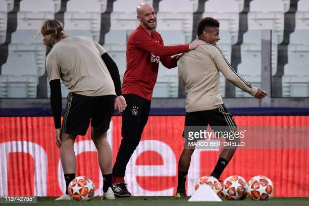Ajax's Brazilian forward David Neres and Ajax's Dutch coach Erik Ten Hag joke during a training session on April 15 2019 at the Juventus stadium in...