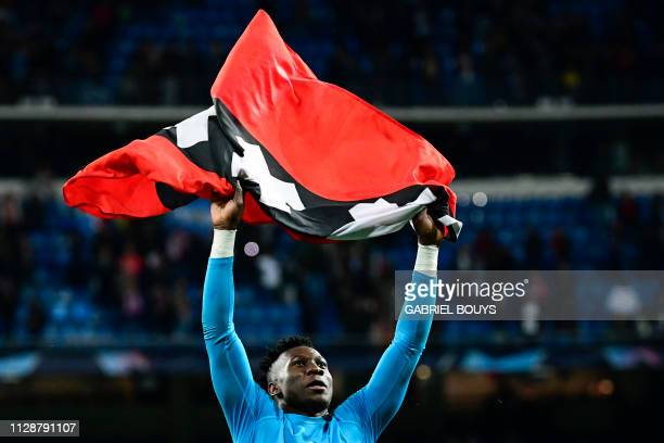 Ajax's Cameroonian goalkeeper Andre Onana celebrates at the end of the UEFA Champions League round of 16 second leg football match between Real...