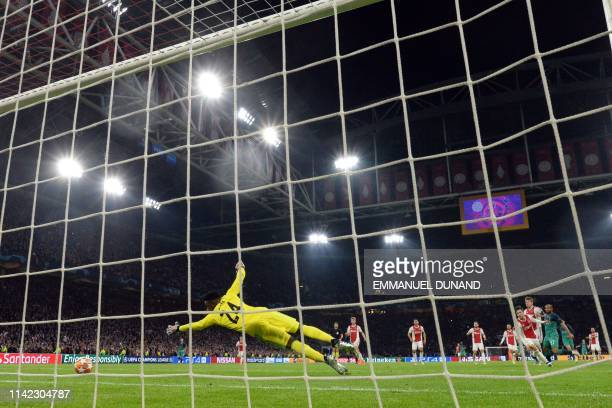 Ajax's Cameroonian goalkeeper Andre Onana concedes a goal during the UEFA Champions League semifinal second leg football match between Ajax Amsterdam...