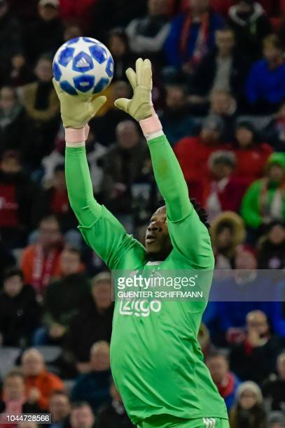 Ajax's Cameroonian goalkeeper Andre Onana makes a save during the UEFA Champions League Group E football match between Bayern Munich and Ajax...