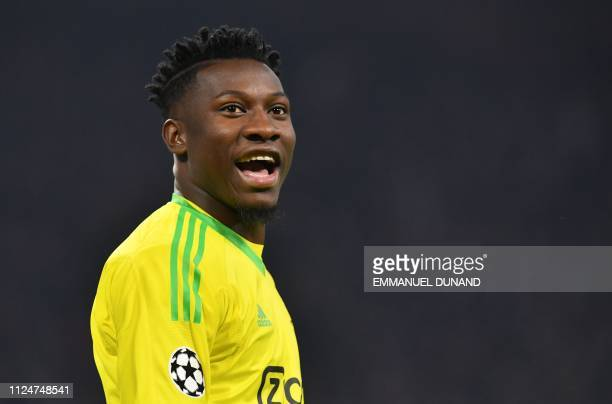 Ajax's Cameroonian goalkeeper Andre Onana reacts during the UEFA Champions league round of 16 first leg football match between Ajax Amsterdam and...