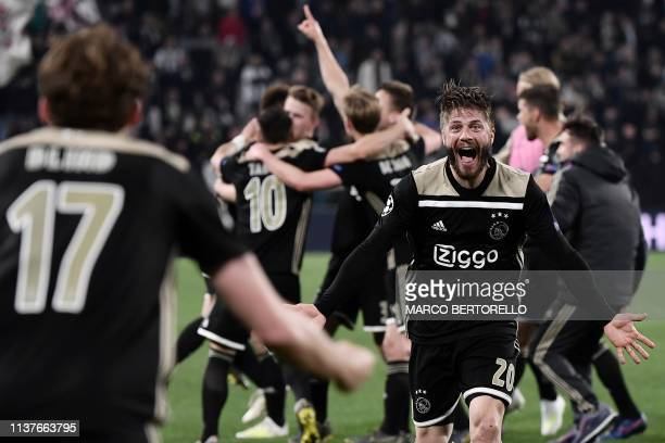 Ajax's Danish midfielder Lasse Schone celebrates at the end of the UEFA Champions League quarterfinal second leg football match Juventus vs Ajax...