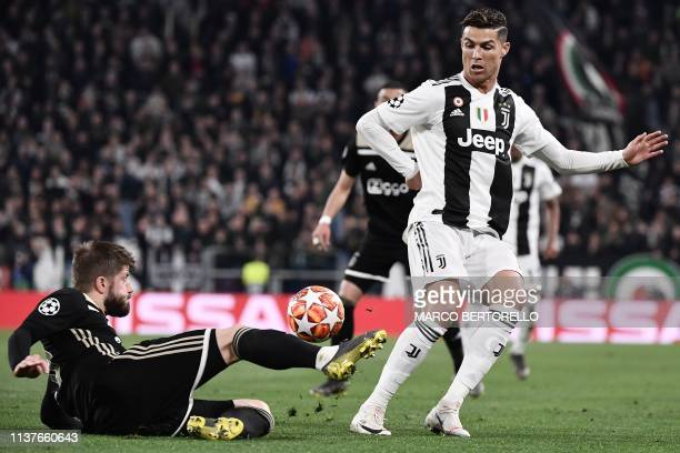 Ajax's Danish midfielder Lasse Schone tackles Juventus' Portuguese forward Cristiano Ronaldo during the UEFA Champions League quarterfinal second leg...