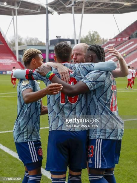 Ajax's David Neres, Dusan Tadic, Davy Klaassen and Lassina Traore celebrate scoring a goal during the Dutch Eredivisie football match between FC...