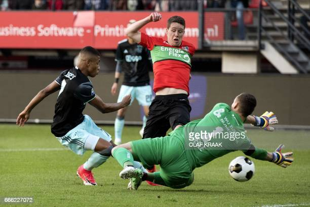Ajax's David Neres scores a goal during the eredivisie match between NEC Nijmegen and Ajax on April 8, 2017 in Nijmegen. / AFP PHOTO / ANP / Olaf...