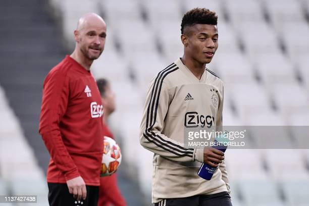 Ajax's Dutch coach Erik Ten Hag and Ajax's Brazilian forward David Neres attend a training session on April 15 2019 at the Juventus stadium in Torino...