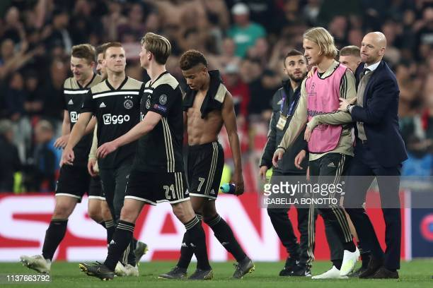 Ajax's Dutch coach Erik Ten Hag escorts his players Ajax's Danish forward Kasper Dolberg Ajax's Brazilian forward David Neres and others as they...