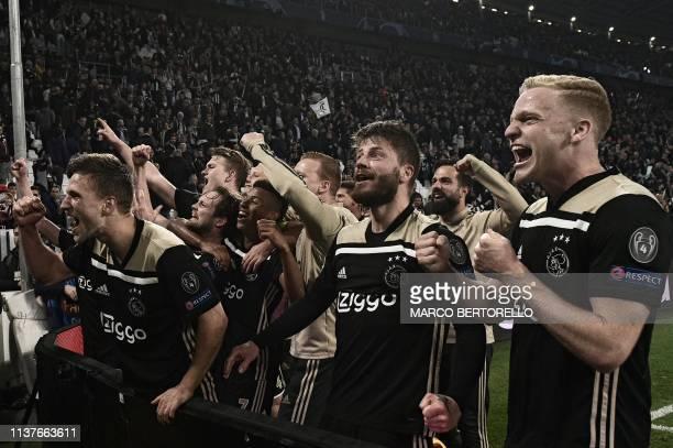 Ajax's Dutch defender Joel Veltman Ajax's Danish midfielder Lasse Schone Ajax's Dutch midfielder Donny van de Beek and teammates celebrate with fans...