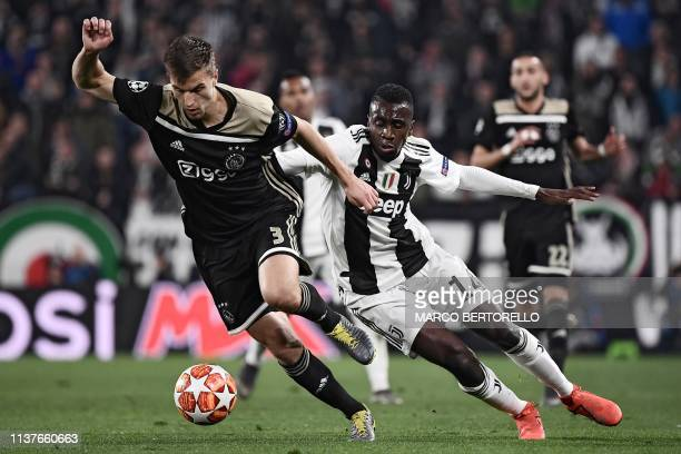 Ajax's Dutch defender Joel Veltman outruns Juventus' French midfielder Blaise Matuidi during the UEFA Champions League quarterfinal second leg...