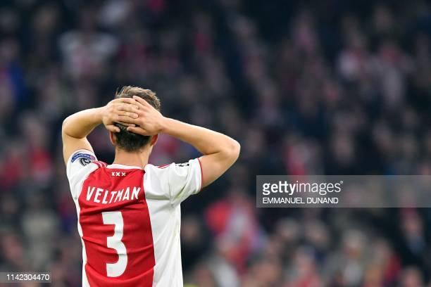 Ajax's Dutch defender Joel Veltman reacts after Ajax Amsterdam lost the UEFA Champions League semifinal second leg football match against Tottenham...