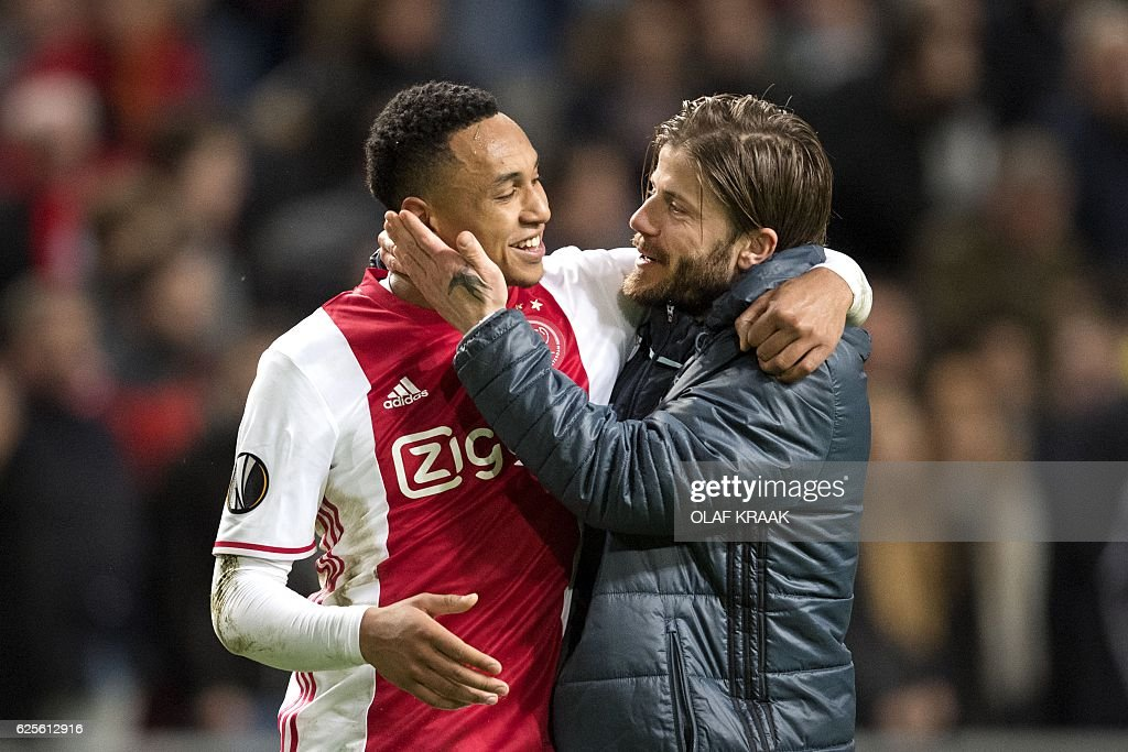 Ajax's Dutch defender Kenny Tete (L) and Danish midfielder Lasse Schone celebrate after winning the UEFA Europa League Group G football match between Ajax Amsterdam and Panathinaikos at the Amsterdam Arena in Amsterdam on November 24, 2016. / AFP / ANP / Olaf KRAAK / Netherlands OUT