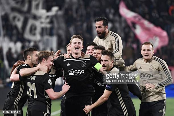 Ajax's Dutch defender Matthijs de Ligt Ajax's Dutch midfielder Frenkie de Jong and teammates celebrate after defeating Juventus during the UEFA...