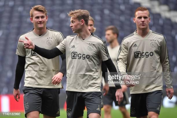 Ajax's Dutch defender Matthijs de Ligt Ajax's Dutch midfielder Frenkie de Jong and Ajax's Dutch midfielder Dani de Wit take part in a training...