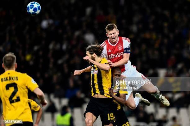 Ajax's Dutch defender Matthijs de Ligt vies for the ball with AEK's Brazilian midfielder Alef Saldanha and AEK's Ukrainian defender Dmytro...