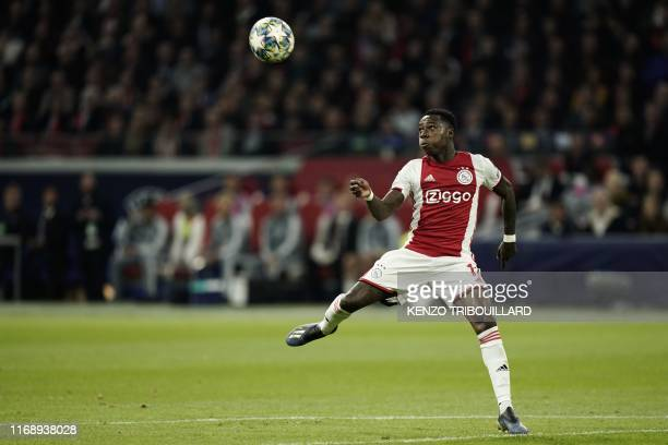 Ajax's Dutch forward Quincy Promes eyes the ball during the UEFA Champions league Group H football match between Ajax FC Amsterdam and LOSC Lille at...