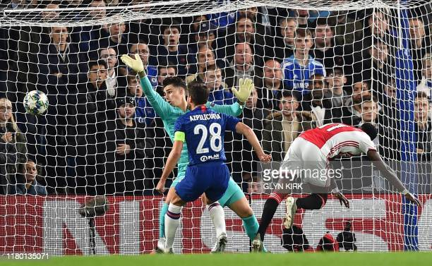 Ajax's Dutch forward Quincy Promes heads past Chelsea's Spanish goalkeeper Kepa Arrizabalaga for their second goal during the UEFA Champion's League...