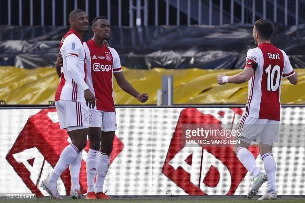Ajax's Dutch forward Sebastien Haller and Serbian forward Dusan Tadic celebrate a goal by Dutch midfielder Ryan Gravenberch during the Toto KNVB cup...