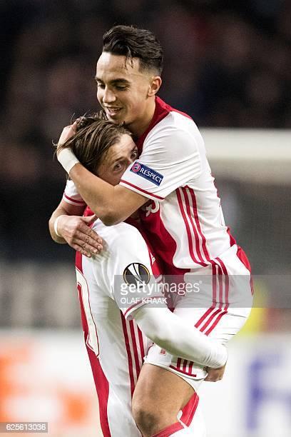 Ajax's Dutch midfielder Abdelhak Nouri and Danish midfielder Lasse Schone celebrate after a goal during the UEFA Europa League Group G football match...