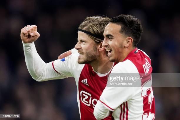Ajax's Dutch midfielder Abdelhak Nouri and Lasse Schone react during a football match on April 5 2017 in Amsterdam Abdelhak Nouri has suffered...