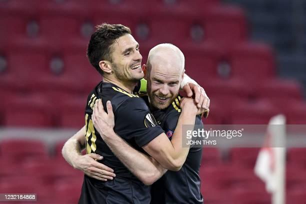 Ajax's Dutch midfielder Davy Klaassen celebrates with Ajax's Serbian forward Dusan Tadic after scoring a goal during the UEFA Europa League...