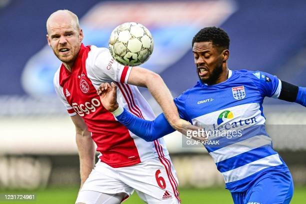 Ajax's Dutch midfielder Davy Klaassen fights for the ball against PEC Zwolle's Dutch defender Kenneth Paal during the Dutch Eredivisie match between...