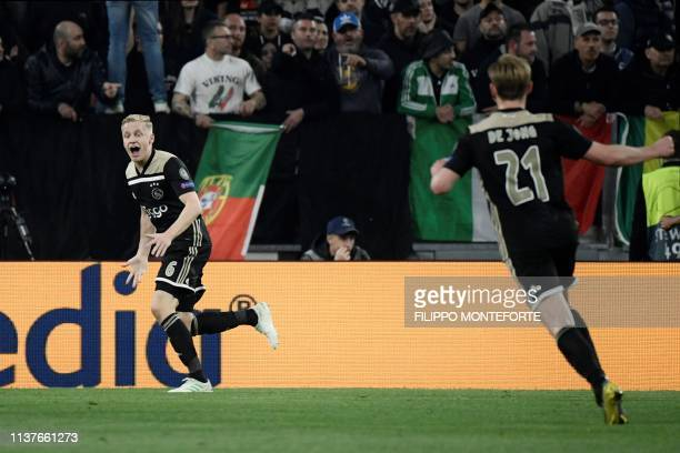 Ajax's Dutch midfielder Donny van de Beek celebrates after scoring an equalizer during the UEFA Champions League quarterfinal second leg football...