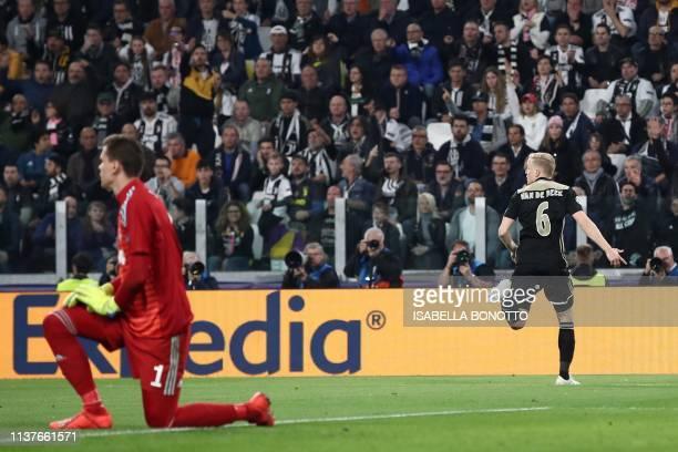 Ajax's Dutch midfielder Donny van de Beek celebrates after scoring an equalizer past Juventus' Polish goalkeeper Wojciech Szczesny during the UEFA...