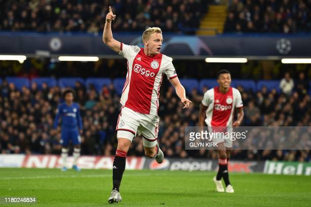 Ajax's Dutch midfielder Donny Van de Beek celebrates after scoring their fourth goal during the UEFA Champion's League Group H football match between...