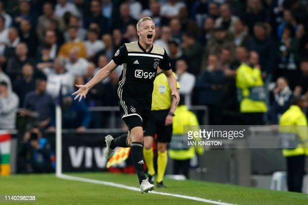 Ajax's Dutch midfielder Donny van de Beek celebrates scoring the opening goal during the UEFA Champions League semifinal first leg football match...