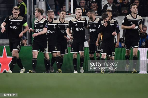 Ajax's Dutch midfielder Donny van de Beek celebrates with teammates after scoring an equalizer during the UEFA Champions League quarterfinal second...