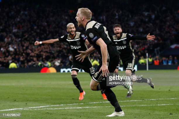 Ajax's Dutch midfielder Donny van de Beek runs to celebrate with teammates after scoring the opening goal of the UEFA Champions League semifinal...