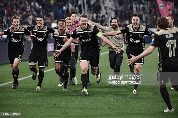 TOPSHOT Ajax's Dutch midfielder Frenkie de Jong Ajax's Dutch defender Matthijs de Ligt and teammates celebrate after defeating Juventus during the...