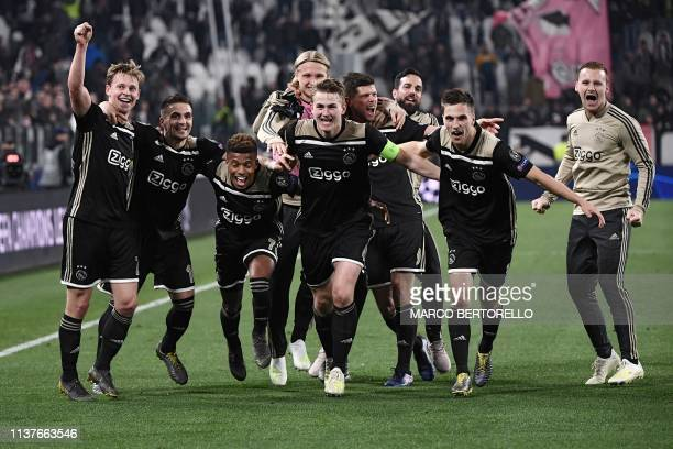 Ajax's Dutch midfielder Frenkie de Jong and teammates celebrate after defeating Juventus during the UEFA Champions League quarterfinal second leg...