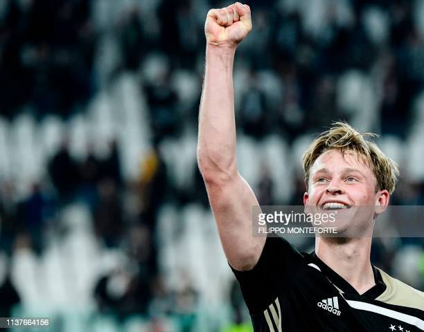 TOPSHOT Ajax's Dutch midfielder Frenkie de Jong celebrates at the end of the UEFA Champions League quarterfinal second leg football match Juventus vs...