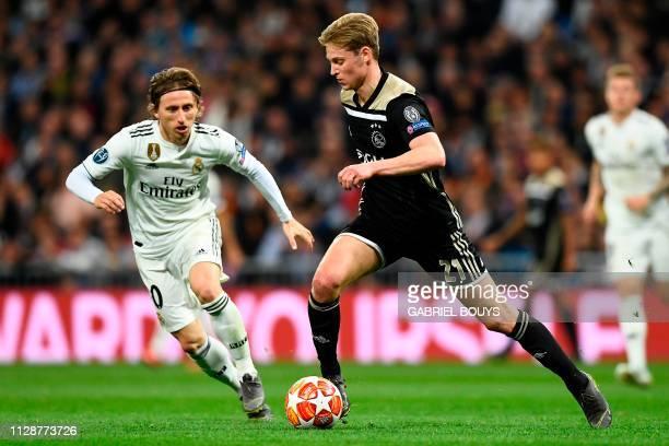 Ajax's Dutch midfielder Frenkie de Jong challenges Real Madrid's Croatian midfielder Luka Modric during the UEFA Champions League round of 16 second...