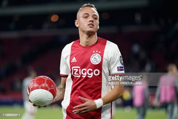 Ajax's Dutch midfielder Noa Lang celebrates after winning with his team at the end of the UEFA Champions league Group H football match between Ajax...