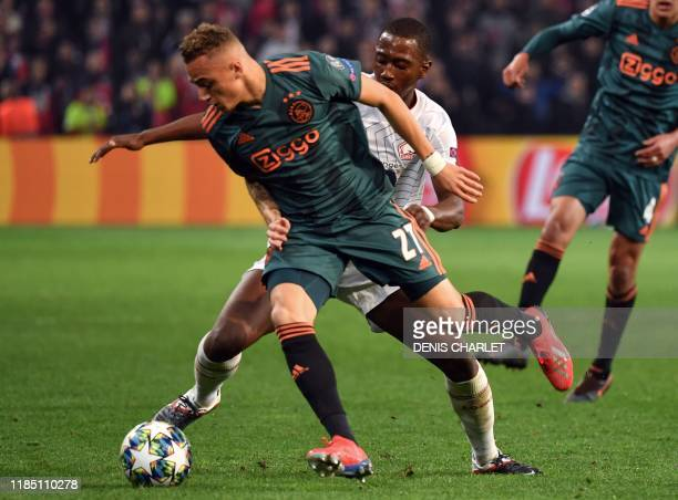 Ajax's Dutch midfielder Noa Lang runs with the ball during the UEFA Champions League group H football match between Lille LOSC and Ajax at the...