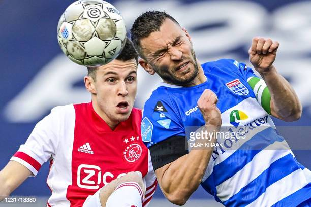 Ajax's Dutch-Moroccan midfielder Oussama Idrissi fights for the ball against PEC Zwolle's dutch defender Bram van Polen during the Dutch Eredivisie...