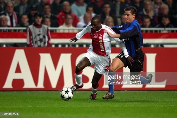 Ajax's Hatem Trabelsi goes past Inter Milan's Francesco Coco