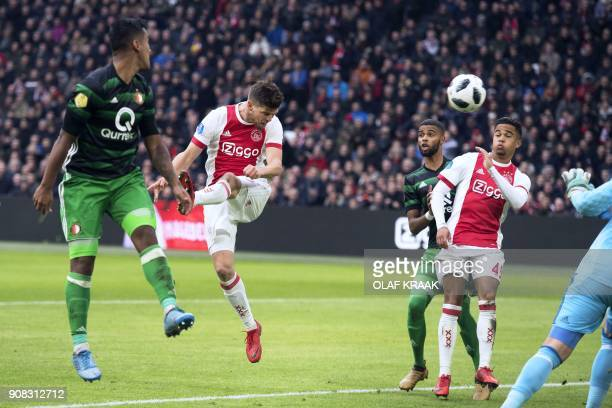 Ajax's Klaas Jan Huntelaar scores his team's second goal during the Dutch Eredivisie football match between Ajax Amsterdam and Feyenoord Rotterdam on...