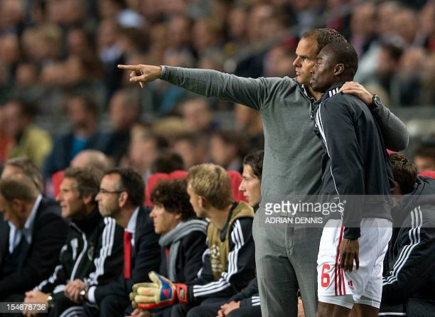 AFC Ajax's Manager Frank De Boer gives instructions to substitute Eyong Enoh against Manchester City during the UEFA Champions League Group D...