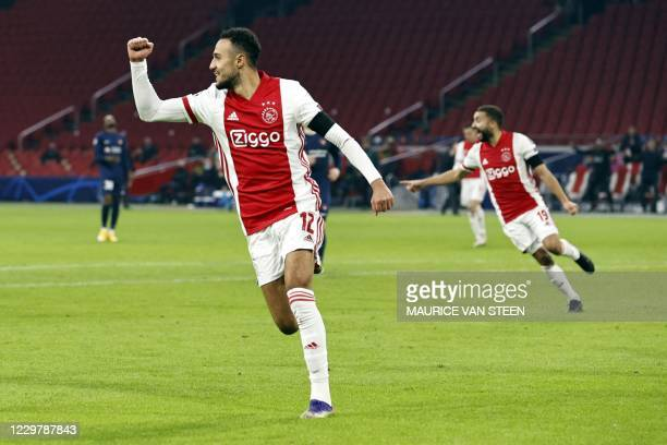 Ajax's Moroccan defender Noussair Mazraoui celebrates after scoring a goal during the UEFA Champions League Group D football match between Ajax and...