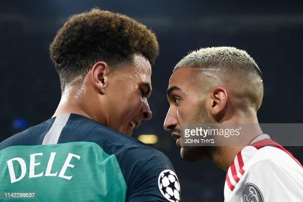 Ajax's Moroccan midfielder Hakim Ziyech and Tottenham's English midfielder Dele Alli react during the UEFA Champions League semifinal second leg...