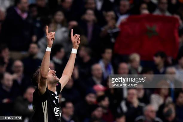 Ajax's Moroccan midfielder Hakim Ziyech celebrates after scoring a goal against Real Madrid's Belgian goalkeeper Thibaut Courtois during the UEFA...