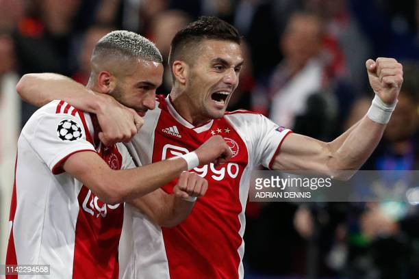 Ajax's Moroccan midfielder Hakim Ziyech celebrates with teammate Ajax's Serbian forward Dusan Tadic after scoring a goal during the UEFA Champions...