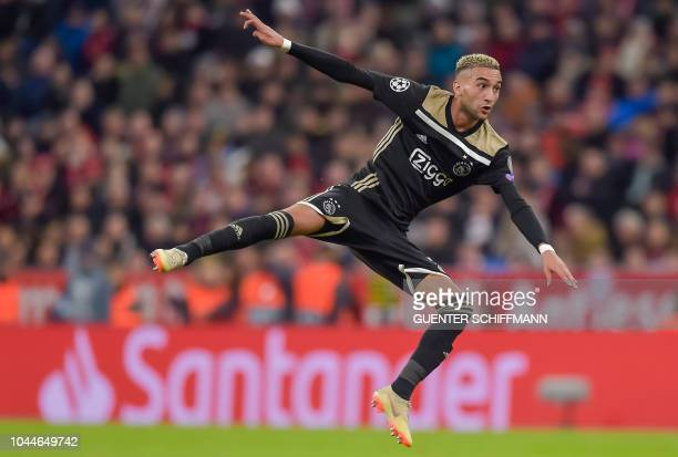 Ajax's Moroccan midfielder Hakim Ziyech jumps during the UEFA Champions League Group E football match between Bayern Munich and Ajax Amsterdam in...
