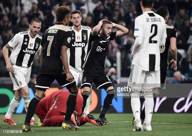 Ajax's Moroccan midfielder Hakim Ziyech reacts after Ajax missed a goal opportunity during the UEFA Champions League quarterfinal second leg football...