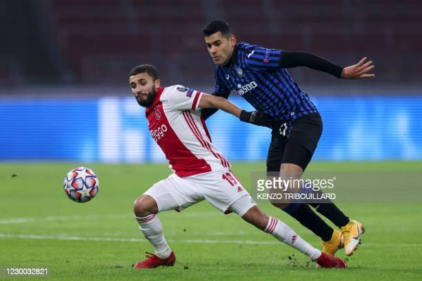 Ajax's Moroccan midfielder Zakaria Labyad fights for the ball with Atalanta's Argentine defender Cristian Romero during the UEFA Champions League...
