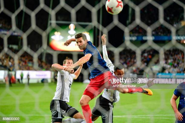 Ajax's Nick Viergever fights for the ball with Rosenborg defenders during the second leg UEFA Europa League playoff match between Rosenborg vs Ajax...