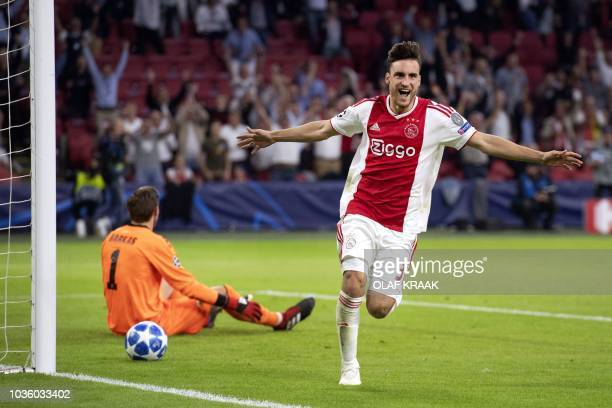 Ajax's Nicolas Tagliafico celebrates after scoring a goal during the UEFA Champions League football match between Ajax Amsterdam and AEK Athens FC at...